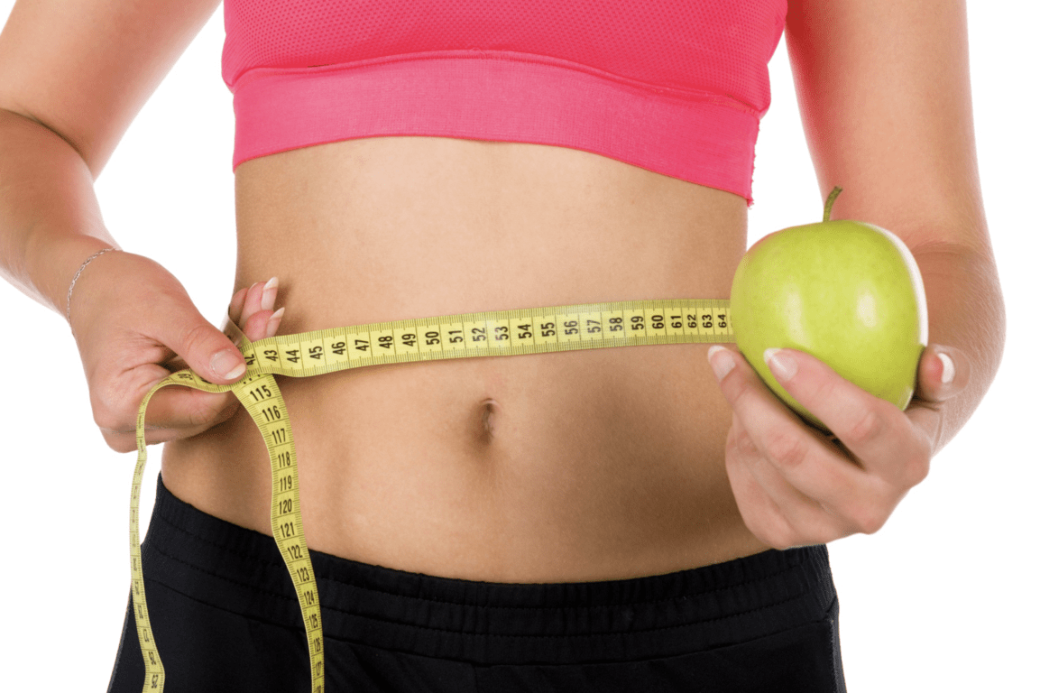 coolsculpting-fit belly using tape measure withn holding an apple