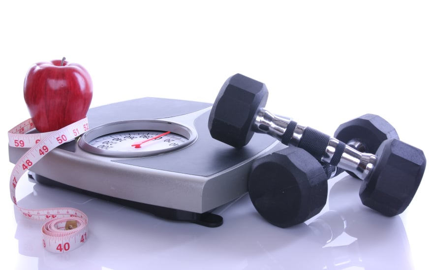 weighing scale,apple and dumbell