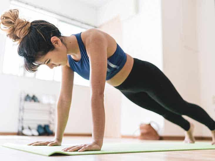 Girl in blue having push ups