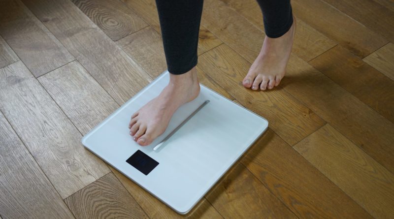 someone standing in the digital scale