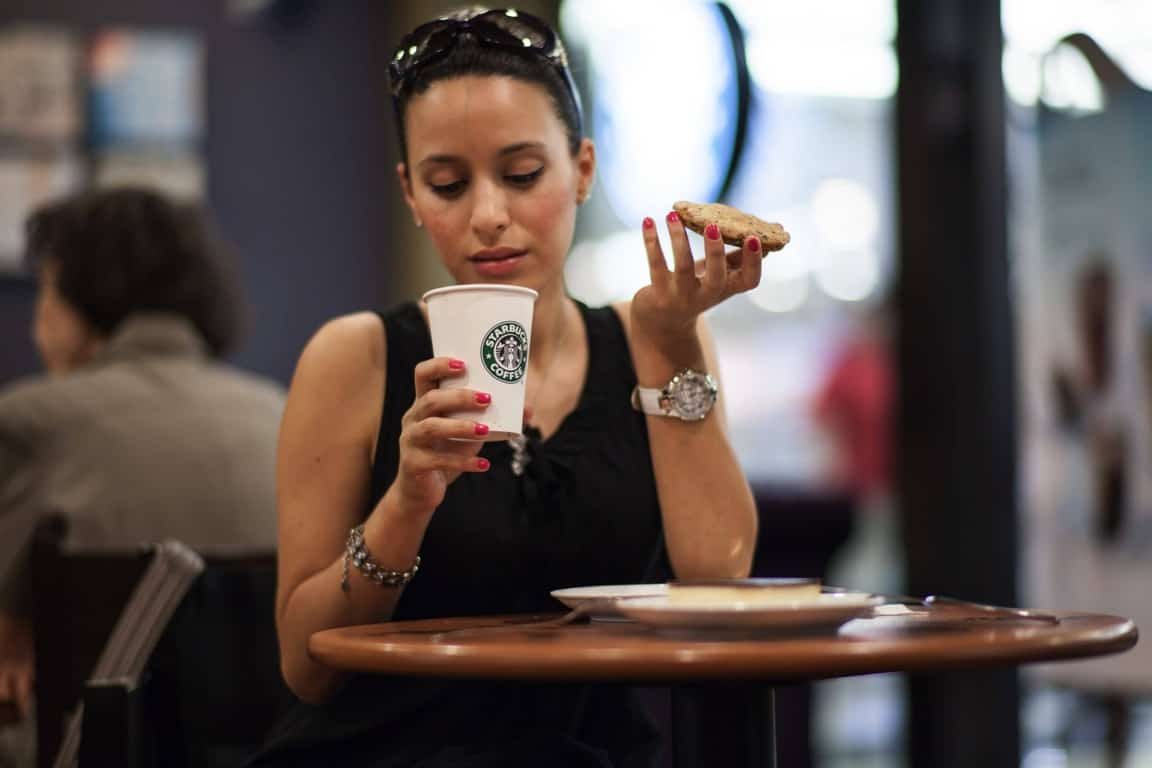 lady drinking coffee at starbucks