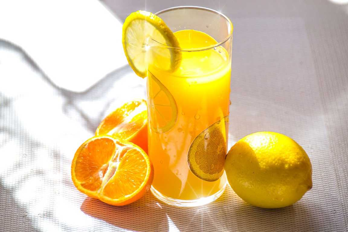 lemon and orange juice in a glass