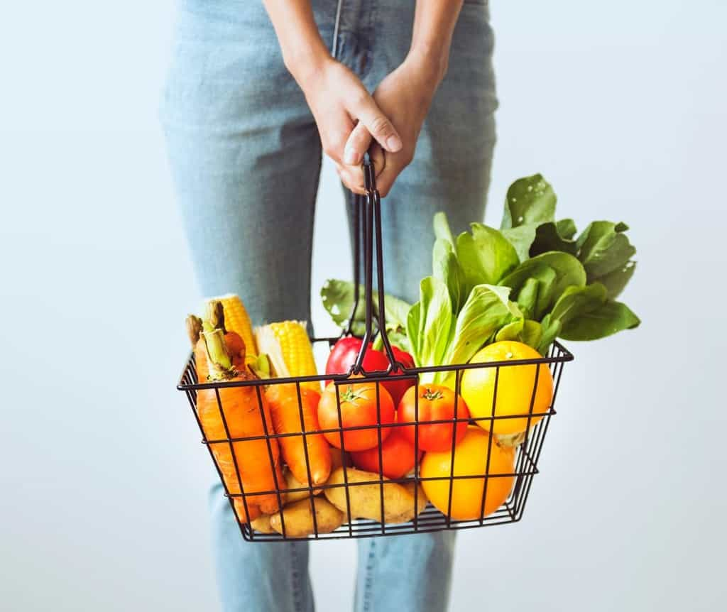 woman carrying basket of vegetables