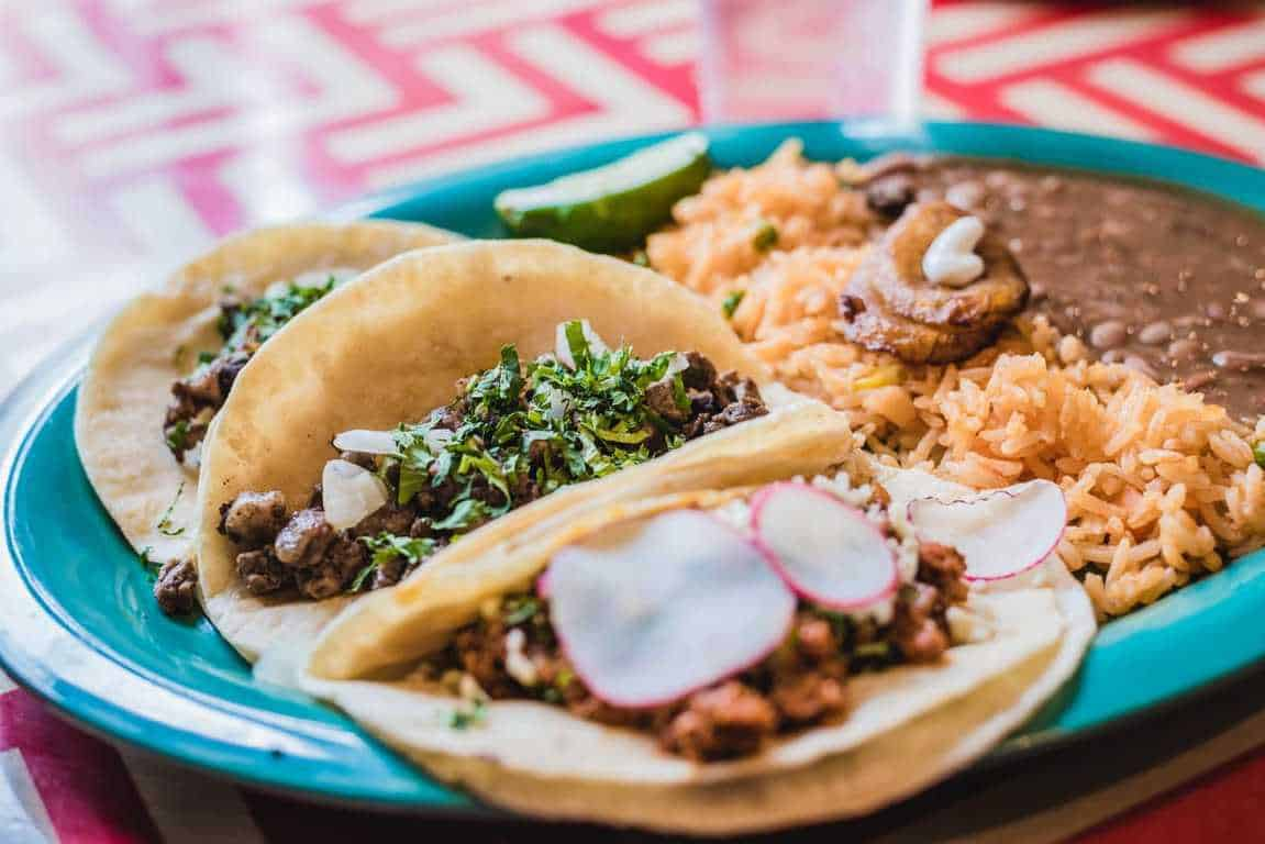 tacos with rice meal on a plate