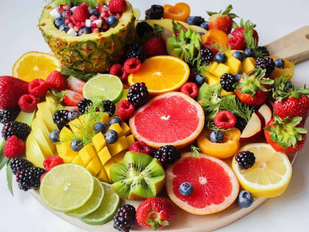 sliced fruits on a tray