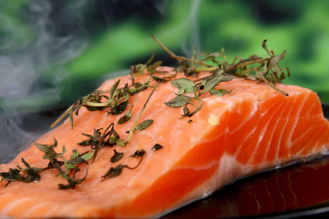 sliced lemon herbs and salmon is one of our 21 day fix recipes