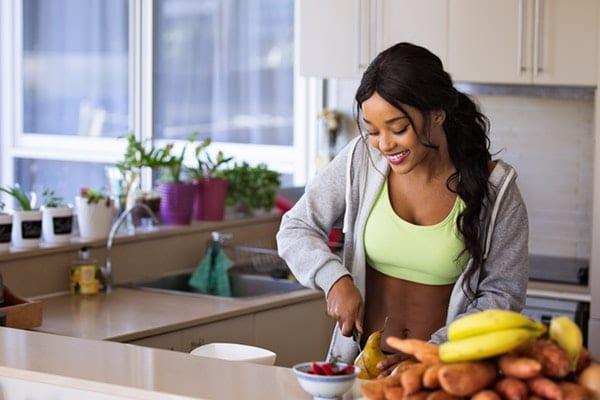 woman cutting fruits