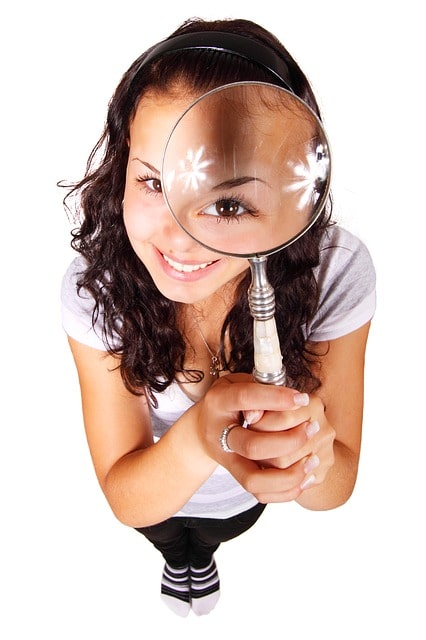 holding magnifying glass