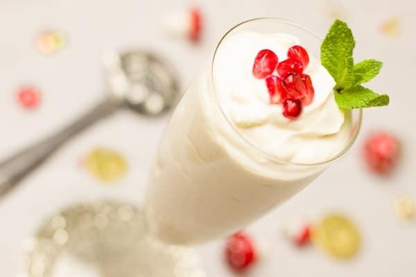 a glass of yogurt drink with strawberry