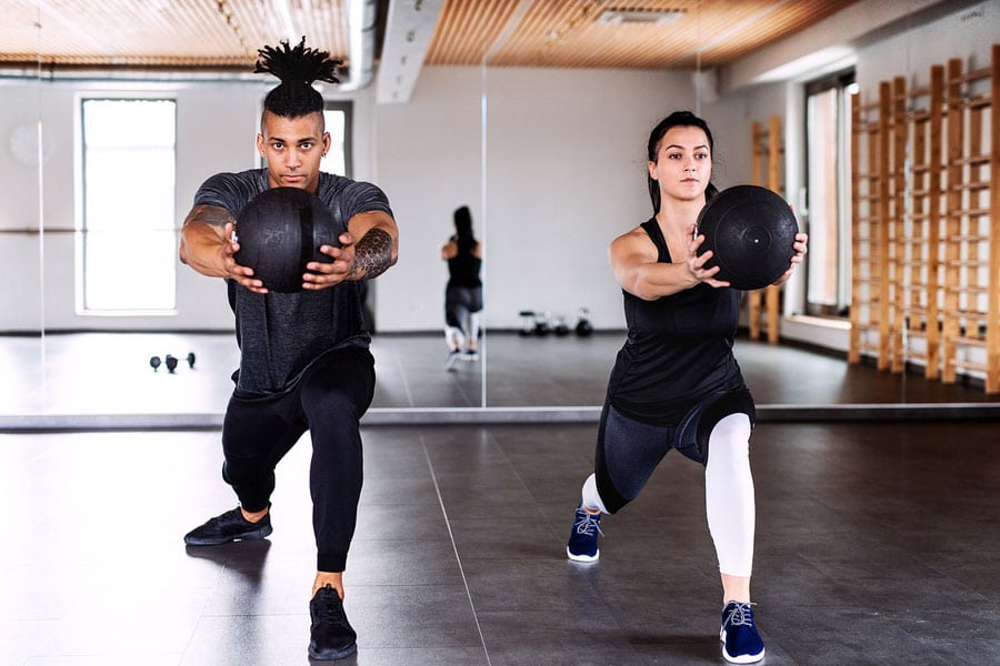 a couple performing exercise on how to lose weight without losing muscle