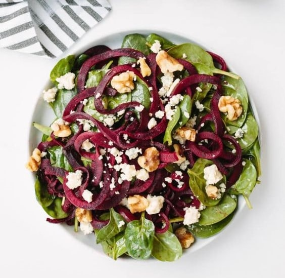 Spiralized beet and baby spinach salad